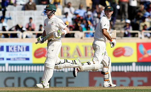 Steve Smith and Glenn Maxwell of Australia in action during the first day of the third cricket test match between India and Australia