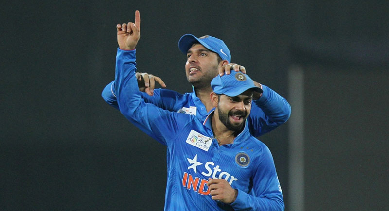 Indian players Virat Kohli and Yuvraj Singh celebrate fall of a wicket