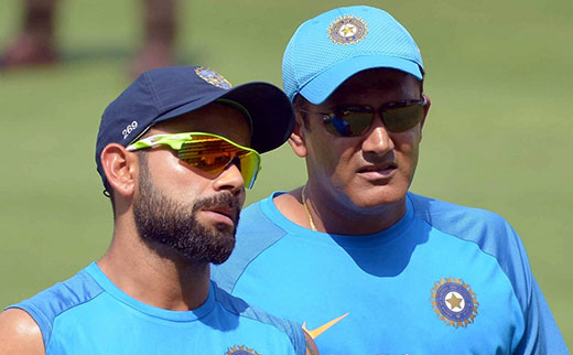 Virat Kohli and coach Anil Kumble during a practice session