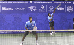 Arun-Prakash-of-Accurate-Aces-serves-as-Sriram-Balaji-looks-on-against-Ramkumar-Ramanathan-and-V-M-Ranjeet-of-Vibrant-Volleyers-Arun-and-Sriram