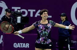Spaniard Carla Suárez Navarro celebrates her win over Latvian Jelena Ostapenko during the final of the WTA Qatar Total Open